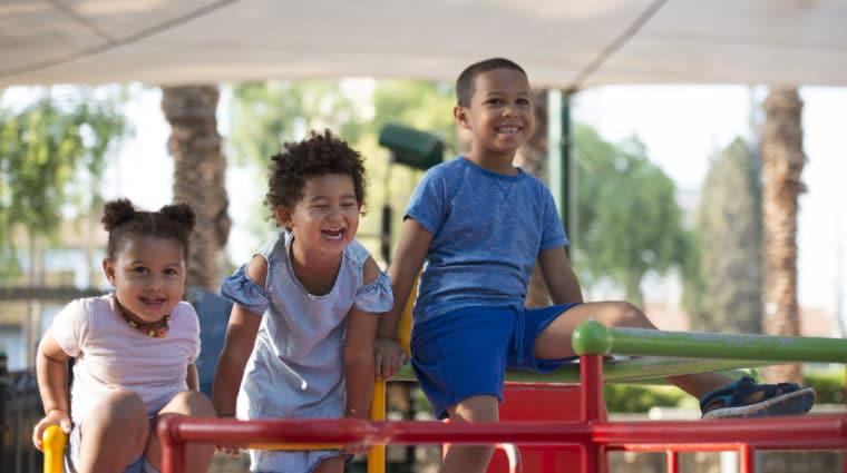 Children Sitting on a Playground in Israel